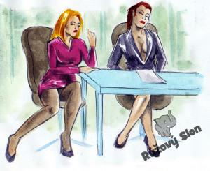 dvě  ženy sedí v kanceláři
