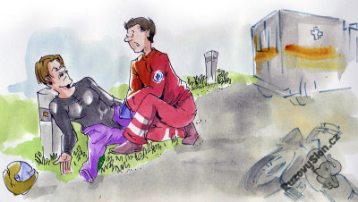 Motorkář ležící na zemi