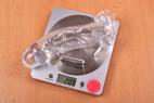 Návlek na penis Vibro Man – vážíme návlek a vibrační patronu, stolní váha ukazuje 209 g