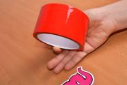 Bondážní páska Rouge – focení v ruce